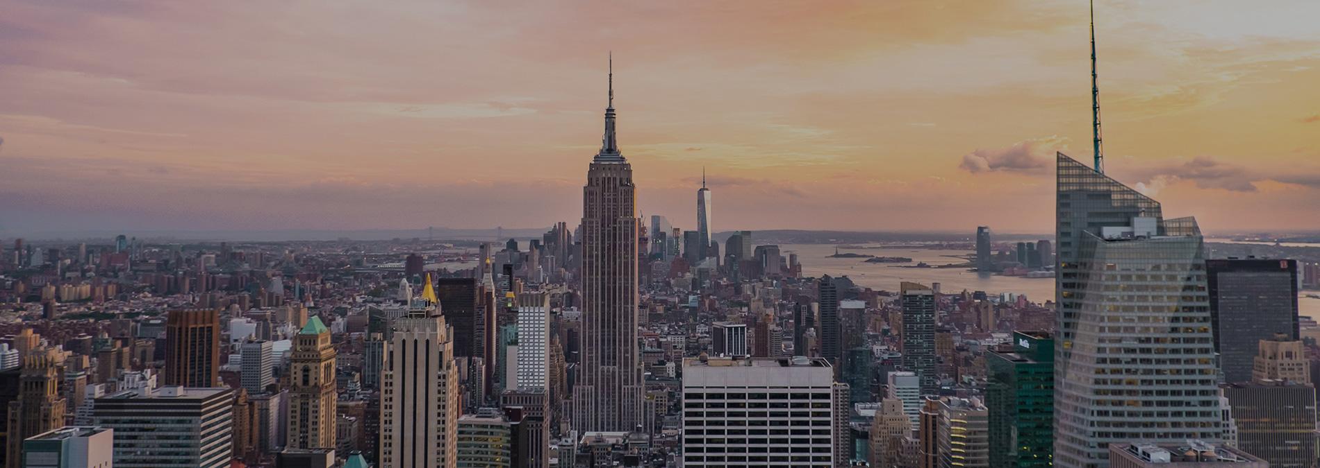 new-york-skyline-empire-state-sunset-1900x675